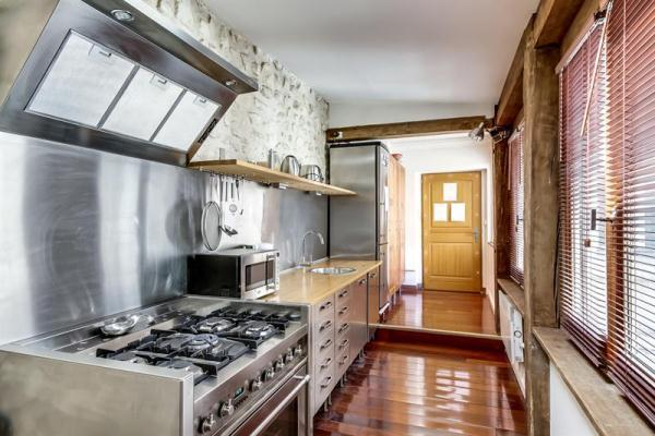 Расположение кухни в доме фото